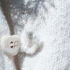 details of handknit cashmere baby vest